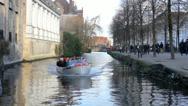 Tourist boat in Bruges, Belgium Stock Footage