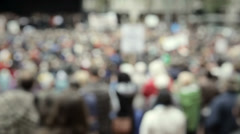 A large gathering of people in a downtown city - stock footage