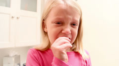 Adorable little girl starts to cry when she tries to pull her loose tooth - stock footage
