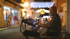 A Puerto Rican man plays keyboard on the streets Stock Footage