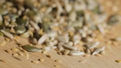 MIxed seeds falling in slow motion Stock Footage