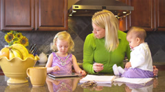 An overworked mother tries to balance work like with her personal life - stock footage