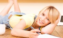 teenage girl with notebook and pen - stock photo
