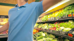 Young family shop for fresh vegetables together Stock Footage