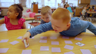 Stock Video Footage of Adorable school children play a card game to help them learn the alphabet