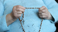 Stock Video Footage of Old, catholic woman praying the rosary.