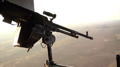 V22 Mv22 Osprey helicopter fires its door gun Stock Footage