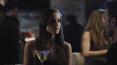 Couples at a table in a club having a drinks and talking with each other - stock footage