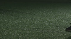 Soccer player places ball on ground. Soccer player kicks ball - stock footage