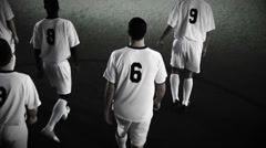 Soccer players march onto the pitch and get ready to start the game Stock Footage