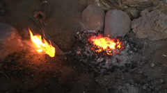 Melting metal for souvenirs in Masai villge, smith Stock Footage