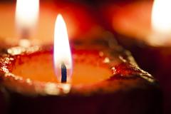 Red candles out of focus Stock Photos