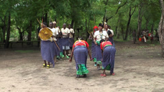Maasai people traditional playing, dancing and singing the songs in the village Stock Footage