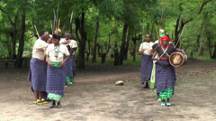 Maasai traditional musicians playing and singing the songs in the village Stock Footage