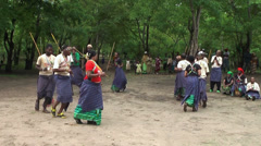 Modern Maasai people dancing with traditional old attributes in the village Stock Footage