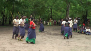 Stock Video Footage of Modern Maasai people dancing with traditional old attributes in the village