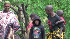 Maasai women parenting with small and teenage children in the village Stock Footage