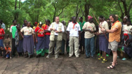 Stock Video Footage of Caucasian man traying to shoot with traditional masai bow, Tanzania