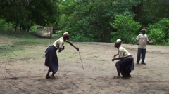 People of Maasai tribe perform fighting with sticks due art performance Stock Footage