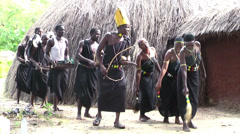 African tribal group in ritual clothes dancing, Rwanda - stock footage