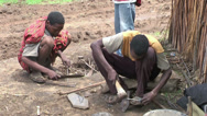 Stock Video Footage of African people in village make some bracelets for sale. Africa