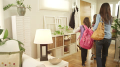 A mother gets ready to take her girls to school. Wide shot. Stock Footage