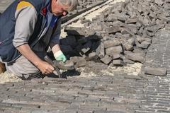 Bricklayer at work Stock Photos