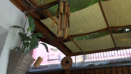 Stock Video Footage of Bamboo wind chime hanging outside of a house, garden ornament, terrace
