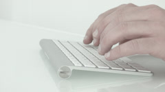 Hands typing on a keyboard. Short. Stock Footage