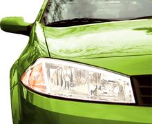 green sport car - front side, half - stock photo