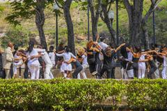 young people dancing in a park in havanna, cuba - stock photo