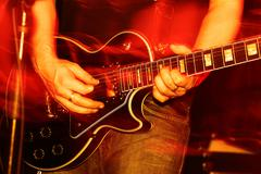 Live Concert guitar player close-up - stock photo