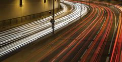 Light trail view at a busy highway Stock Photos