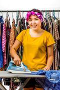 Asian woman housework Stock Photos