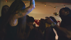 Young adults have fun dancing together at a house party Stock Footage