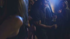 Stock Video Footage of A bunch of young adults dance together at a house party