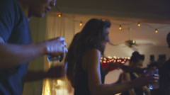 Stock Video Footage of Young people of all colors dance and mingle at a house party
