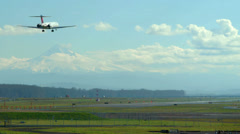 Airliner landing at  the Portland, Oregon airport with Mt. Hood in background Stock Footage