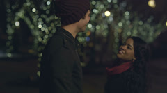 A young couple give each other a huge hug as the nights date comes to an end Stock Footage