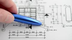 Check the measurements and dimensions on the blueprint with a pen Stock Footage
