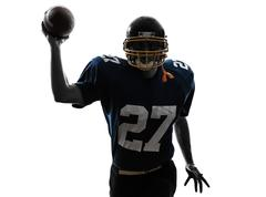 quarterback american throwing football player man silhouette - stock photo
