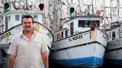 A older Mexican man poses for the camera down by the fishing docks - stock footage