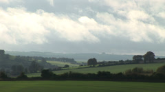 Clouds moving on England countryside Stock Footage