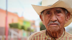 A old Mexican cowboy poses for the camera in a small town in Mexico Stock Footage