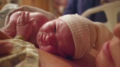 A newborn baby born just minutes before on her mothers chest Stock Footage