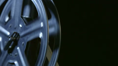 Spinning film reel of movie projector closeup Stock Footage