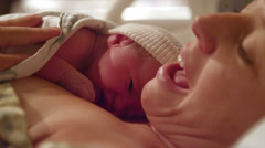 A tired mother with her newborn baby that was born minutes before - stock footage