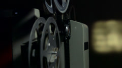 Dolly: Screening movies on vintage film projector Stock Footage
