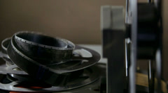 Vintage 16 mm movie projector and film reel closeup Stock Footage