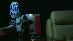 Vintage 16 mm movie projector showing film Stock Footage